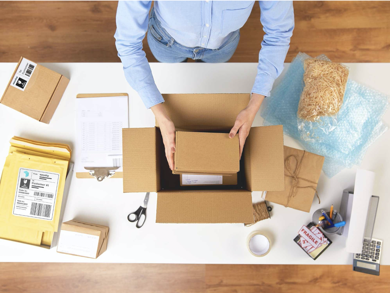 eCommerce merchant packaging a product