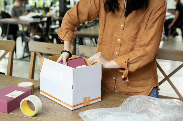 eCommerce merchant packing a product using their own packaging