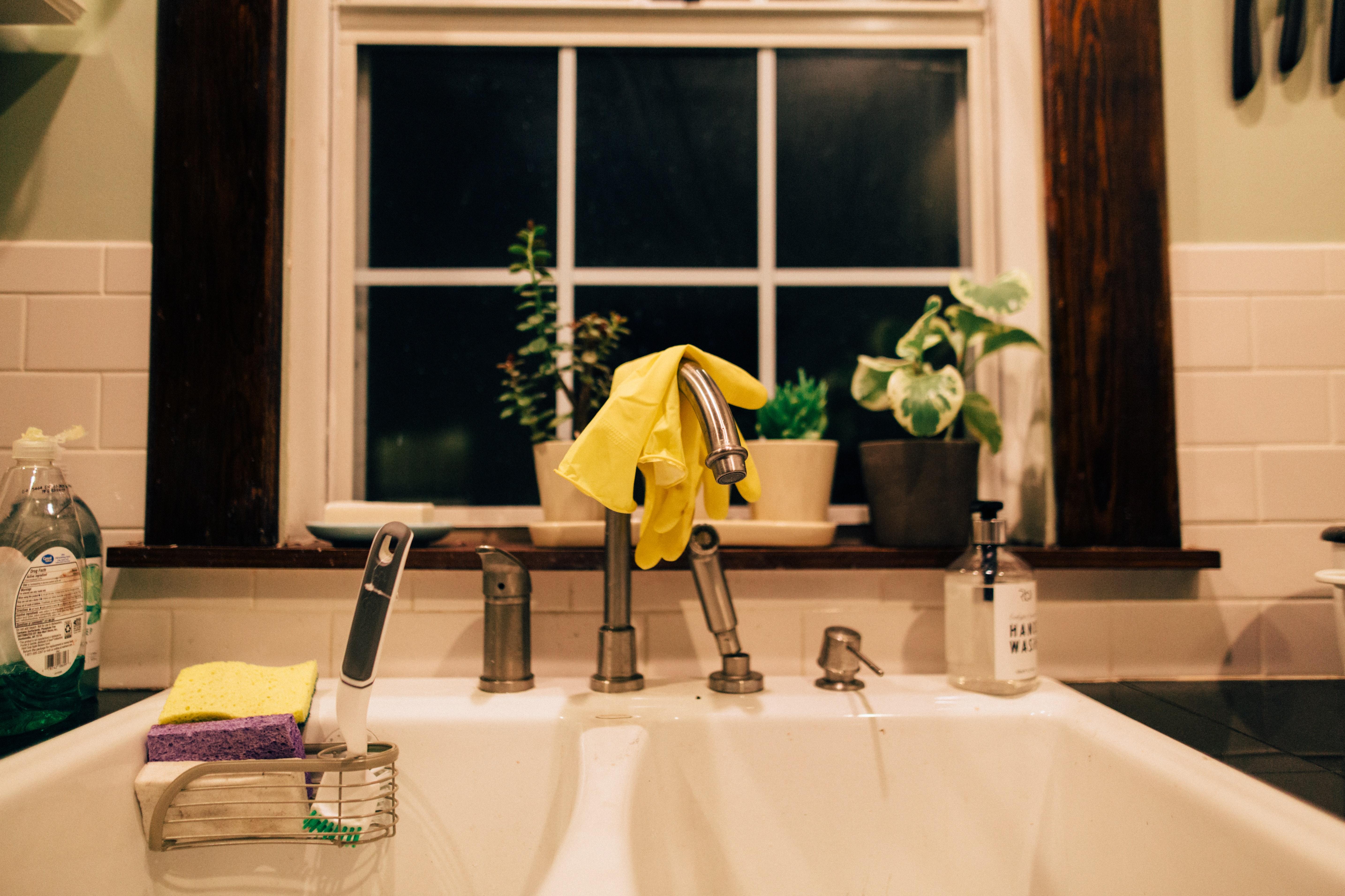 dishwashing gloves in the sink