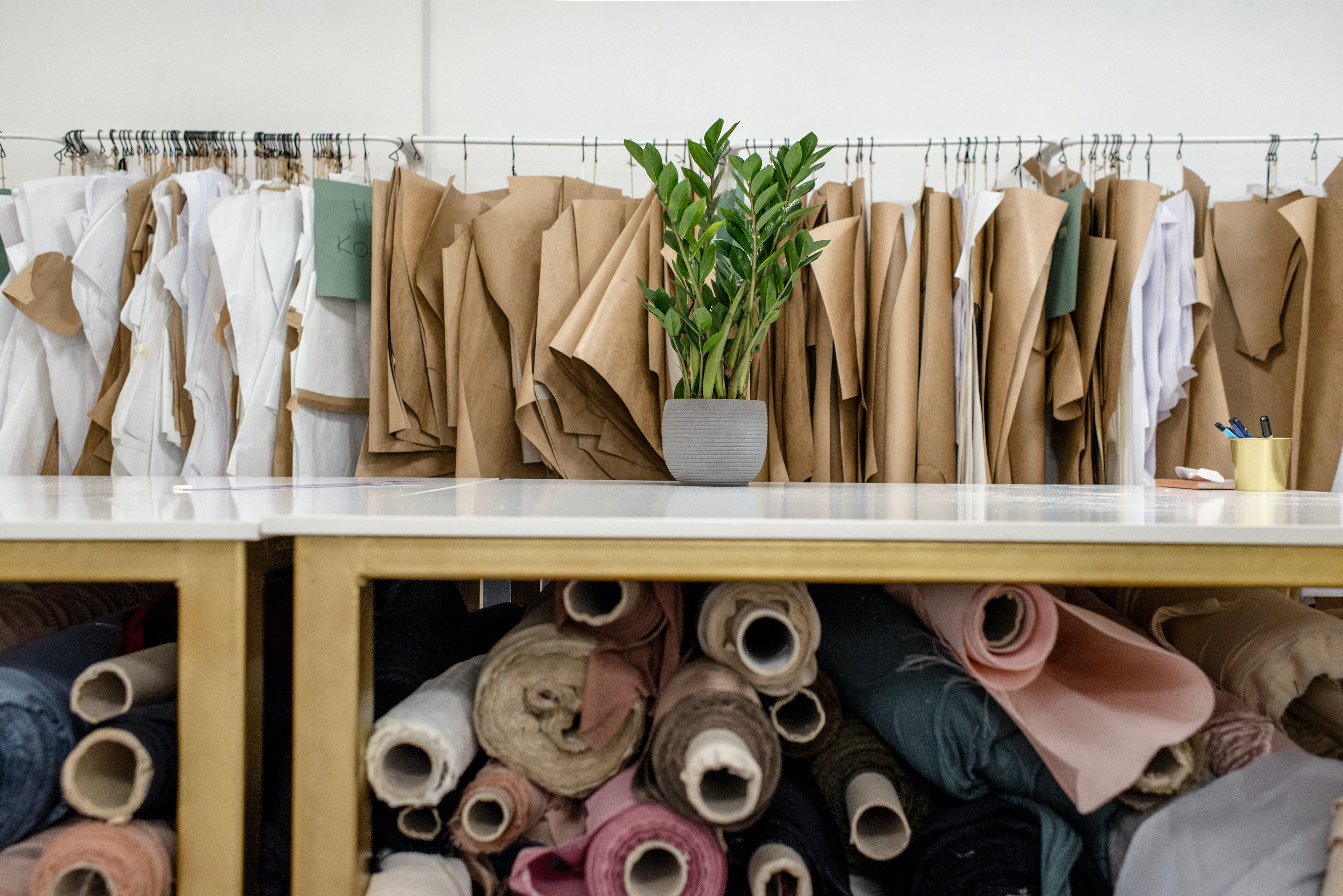 clothing store with rolls of fabric
